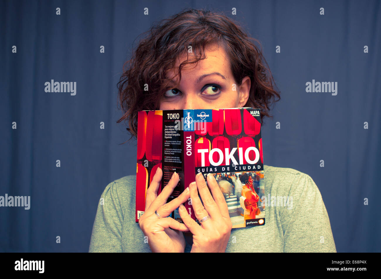 Preparing a trip to Tokyo with travel guides - Stock Image