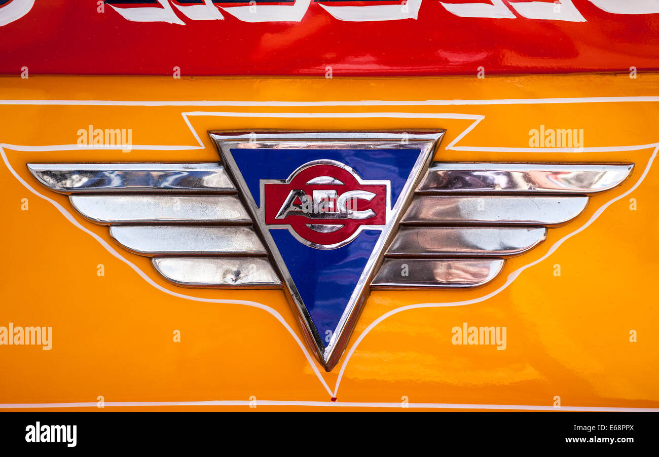 An AEC coach badge on front of an old Maltese vintage bus, Malta. - Stock Image