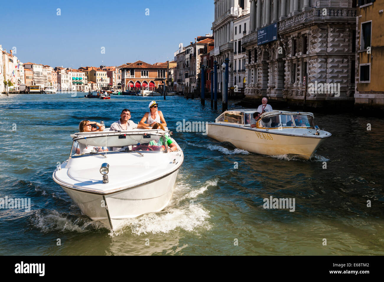 Sightseers cruising the Grand Canal in a small motorboat, Venice, Veneto,  Italy.