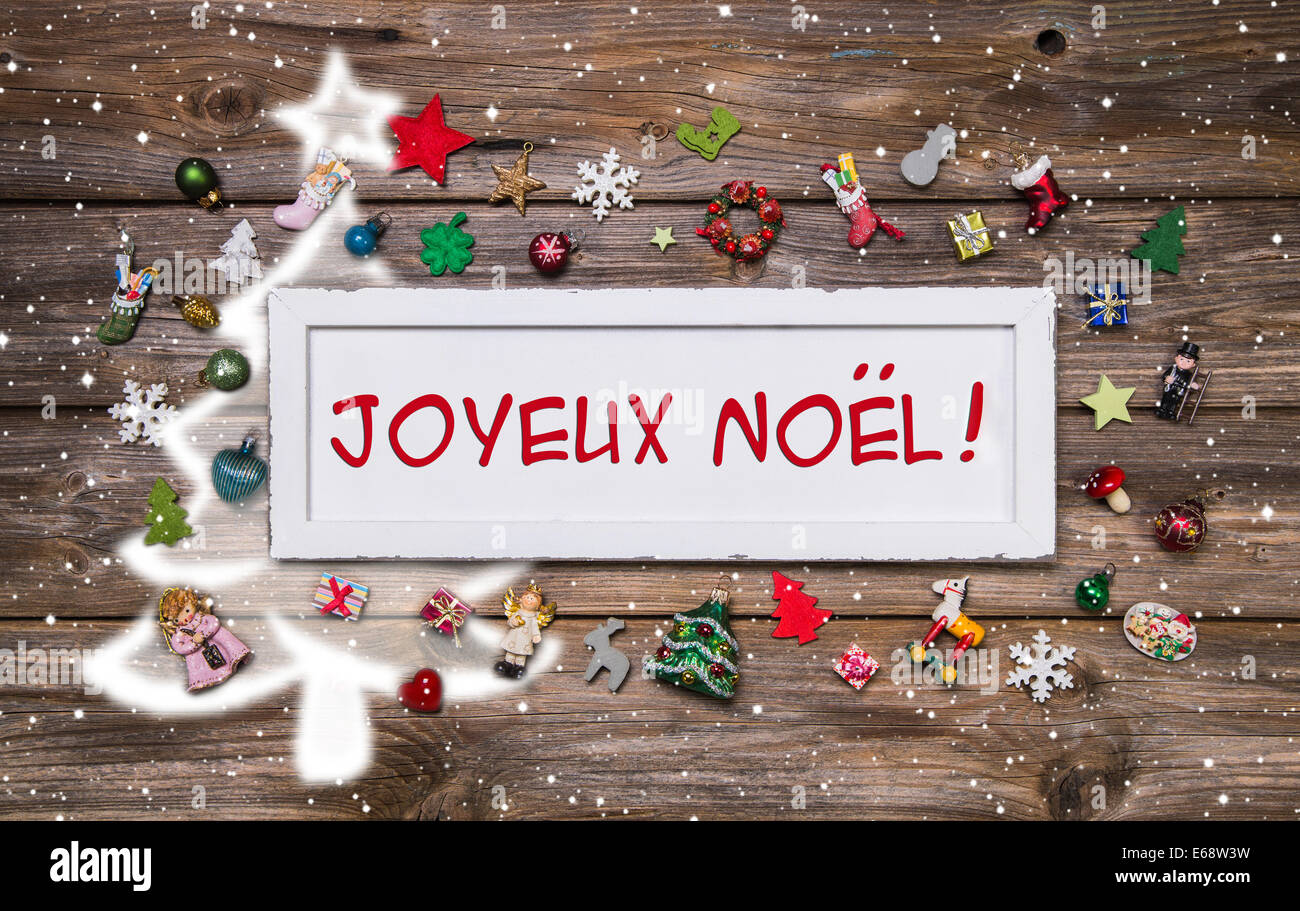 Merry christmas greeting card with french text decoration stock merry christmas greeting card with french text decoration multicolored with miniatures on wooden background with sign m4hsunfo