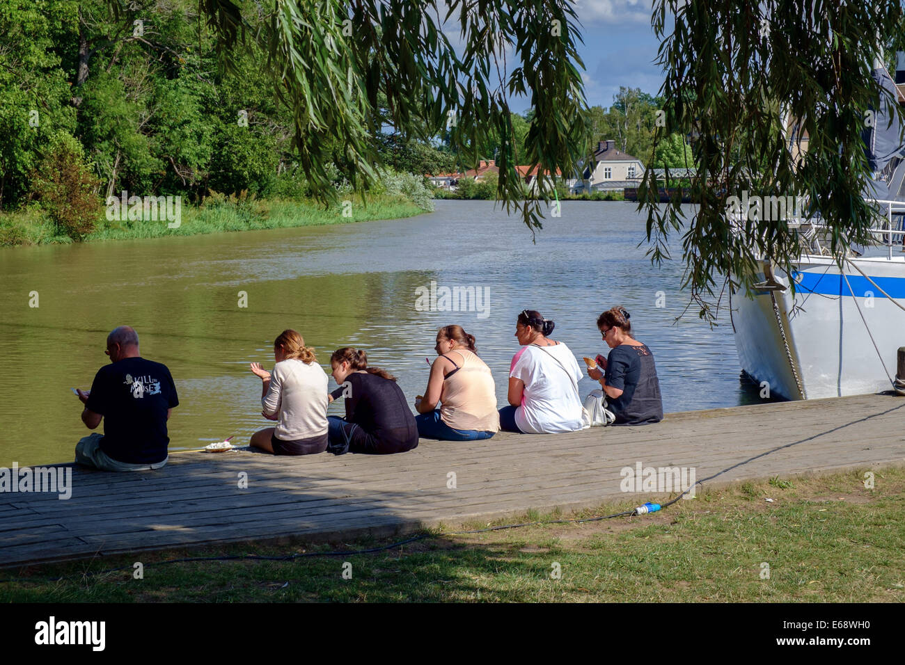 Tourists enjoy an ice cream break at Gota Canal in Soderkoping, Sweden. - Stock Image
