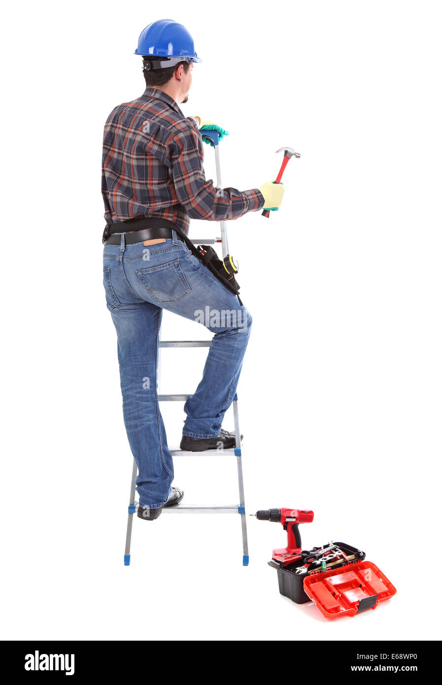 Carpenter with hammer on the stepladder Stock Photo
