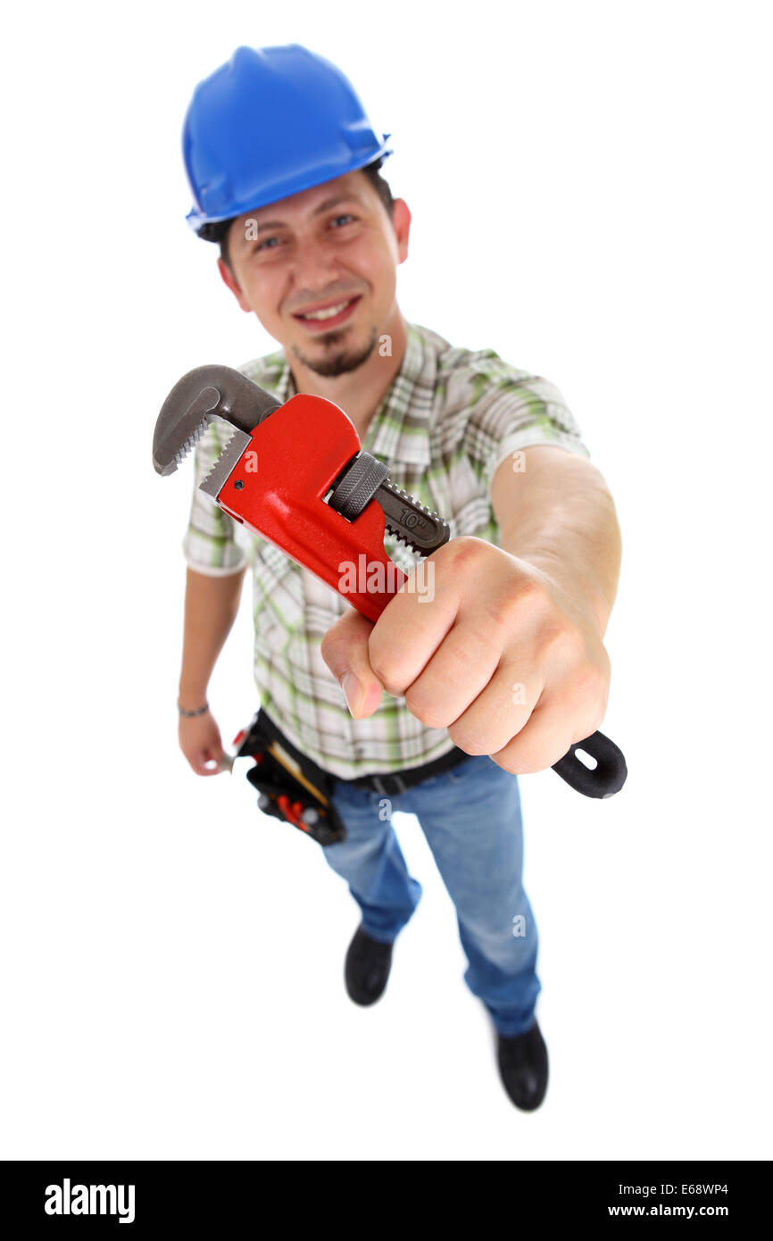 A plumber holding a red pipe wrench. - Stock Image