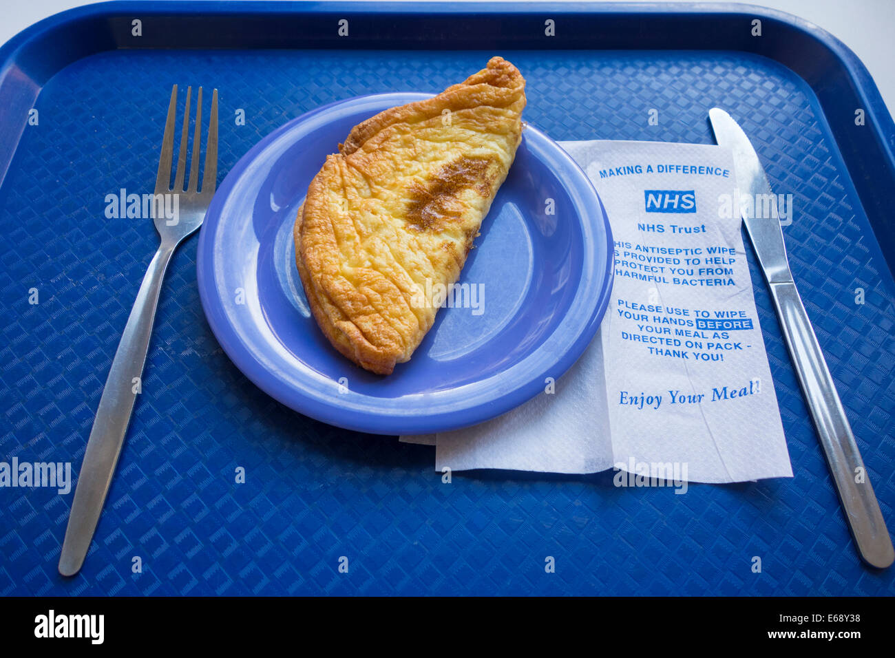 Patients food (omelette) on tray in NHS hospital. England, UK - Stock Image
