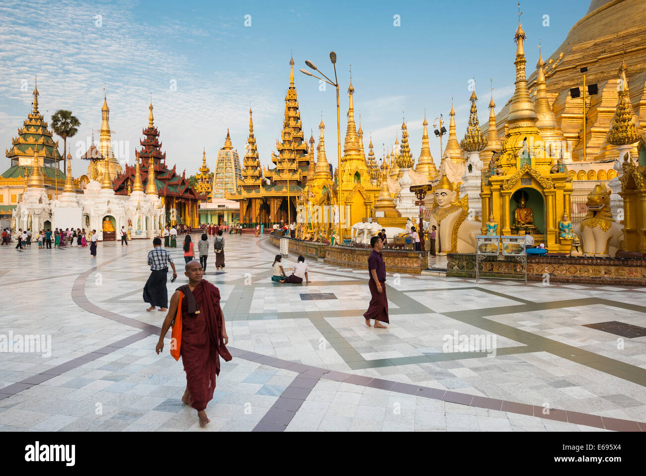Monks, worshipers and visitors, shrines, stupas, chedis, Shwedagon Pagoda, Singuttara Hill, Yangon, Yangon Region, - Stock Image