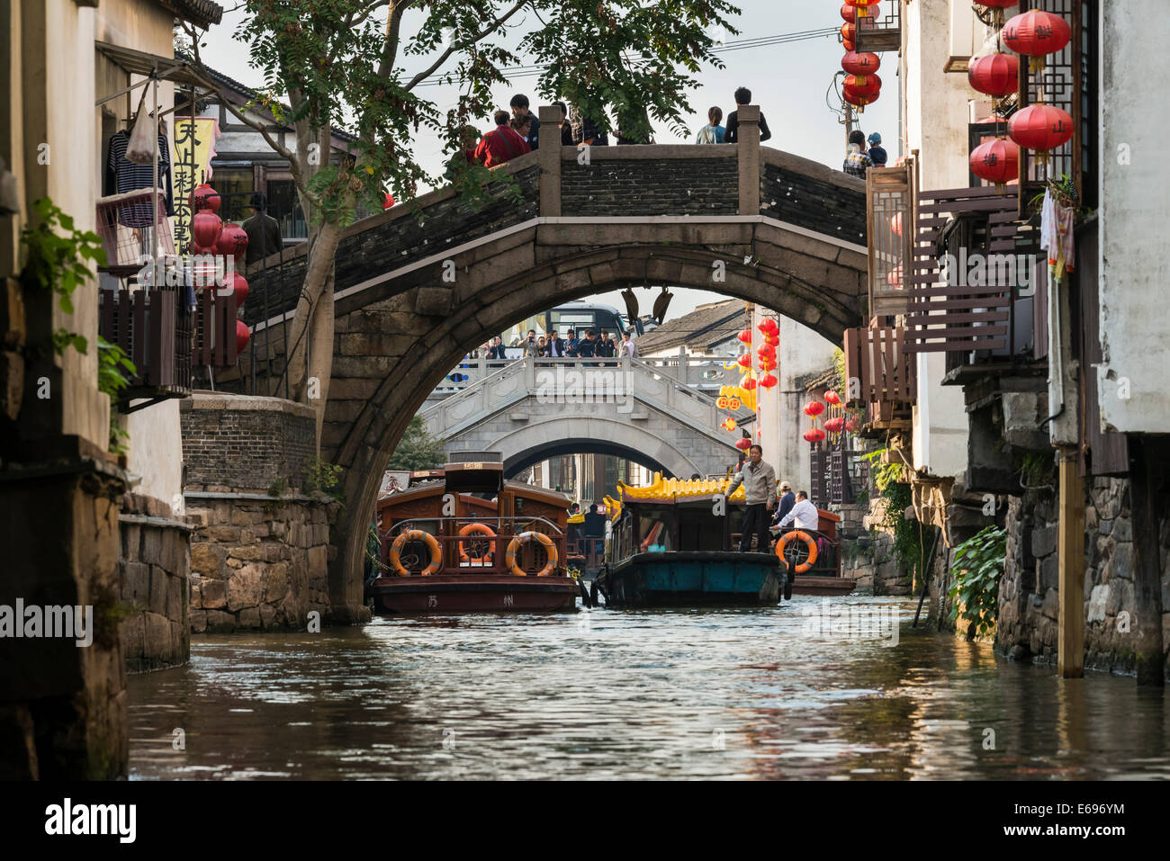 Bridge over a waterway with boats, Suzhou, China - Stock Image