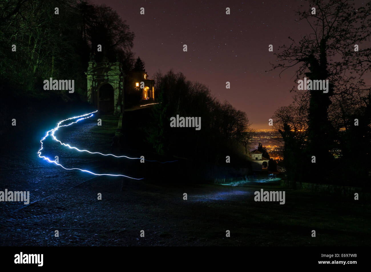 People with flashlights on New Year's Eve, at Chapel XI and IX on the pilgrimage trail to Santa Maria del Monte, - Stock Image