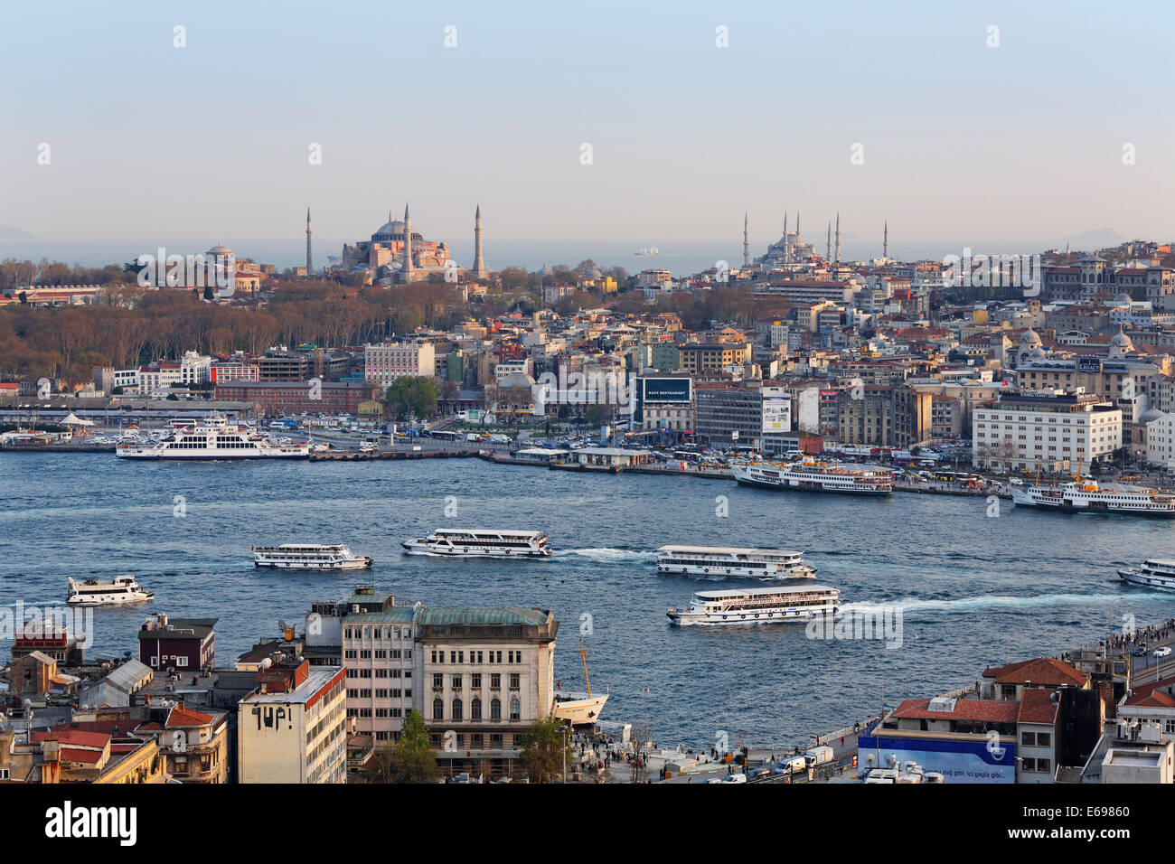Hagia Sophia and Sultan Ahmed Mosque or Blue Mosque, ferries, Golden Horn, view from Galata Tower, Istanbul, European - Stock Image