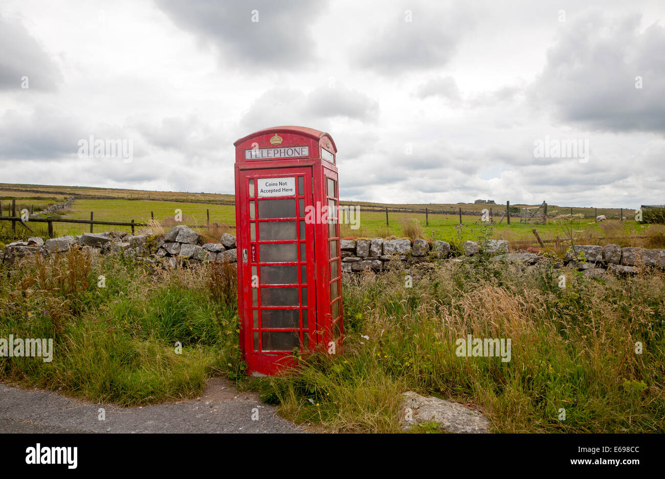 Red telephone box booth on moorland near Princetown, Dartmoor national park, Devon, England - Stock Image