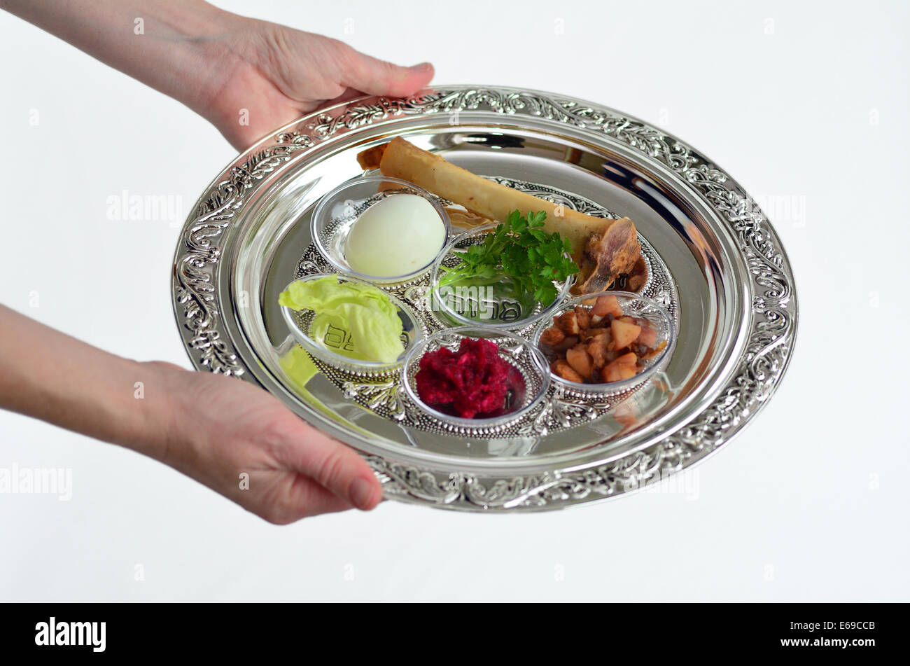 Jewish Woman Hands Carry Passover Seder Plate With The Seventh Stock
