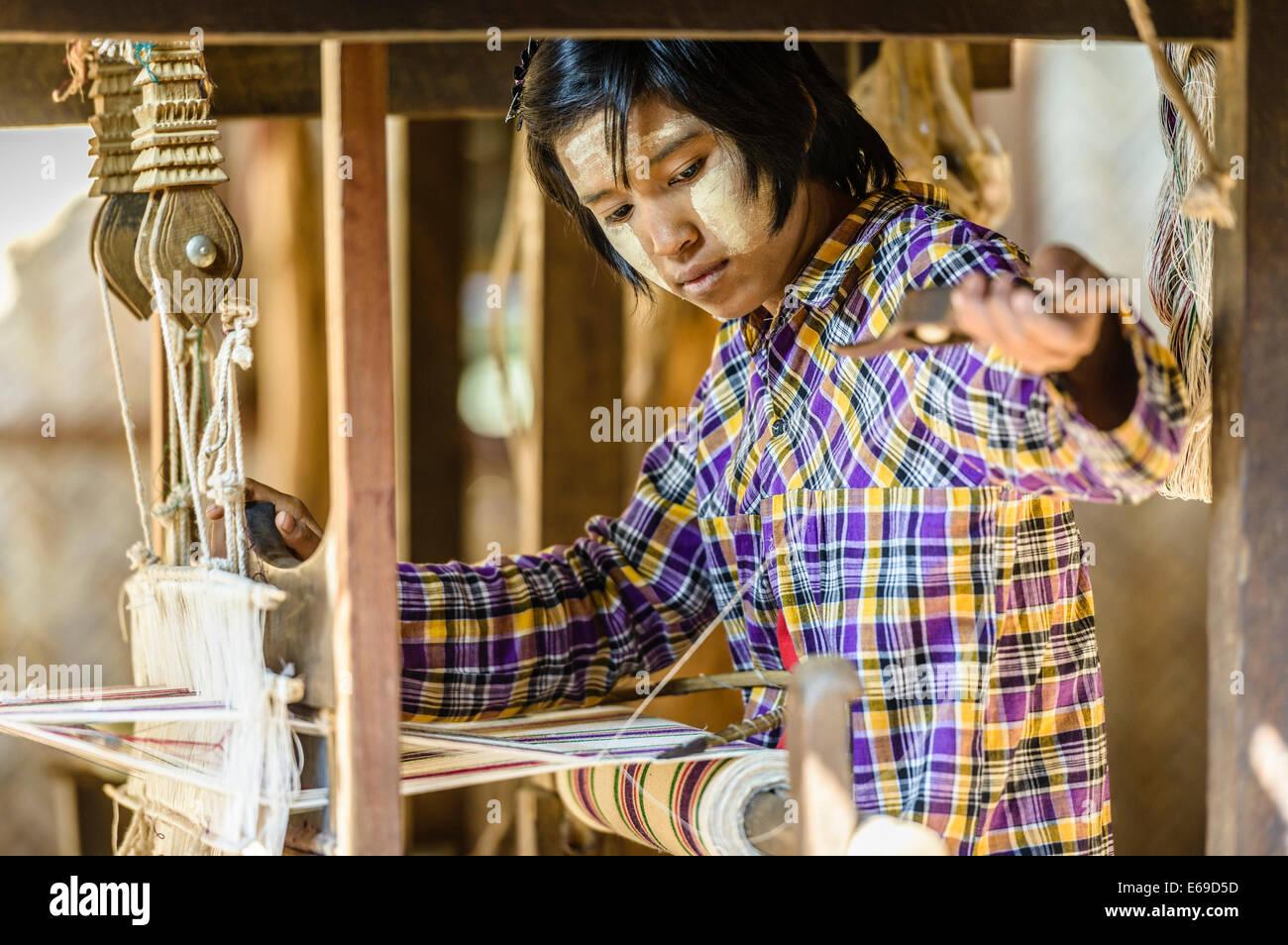Asian girl weaving fabric Stock Photo