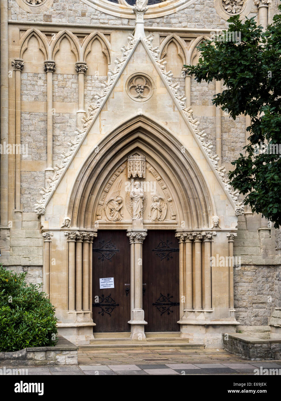 St. Mathias Anglican Church entrance - stone Gothic style Grade ll listed building -  Richmond upon Thames, Surrey, - Stock Image