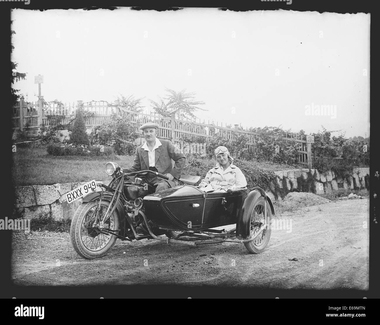 motorcycle,historical vehicle,sidecar machine,historical photo - Stock Image