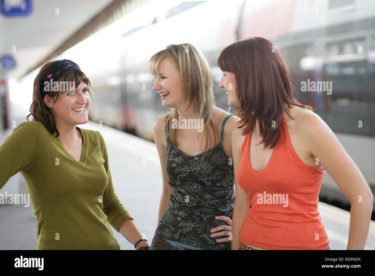 young woman,platform,friends,goodbye - Stock Image