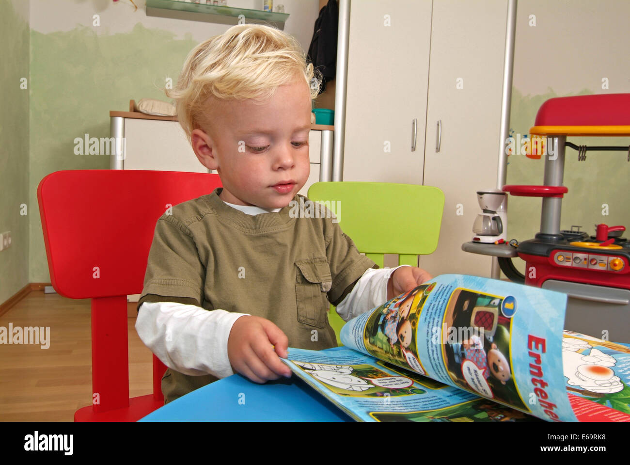 boy,turning page,preschool,comic - Stock Image