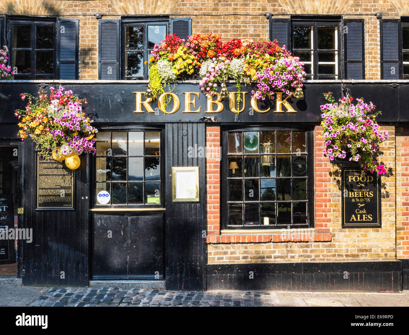 Roebuck traditional English pub with colourful flower baskets in Summer - Richmond upon Thames, Surrey, London, - Stock Image