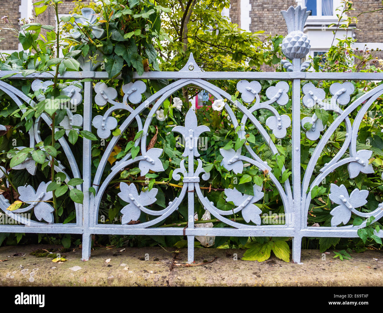 Decorative wrought iron metalwork fence with floral design around ...