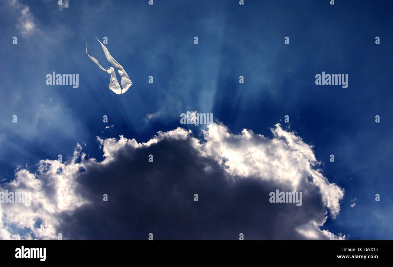 cloudscape,sunbeams, sun beams,kite - Stock Image