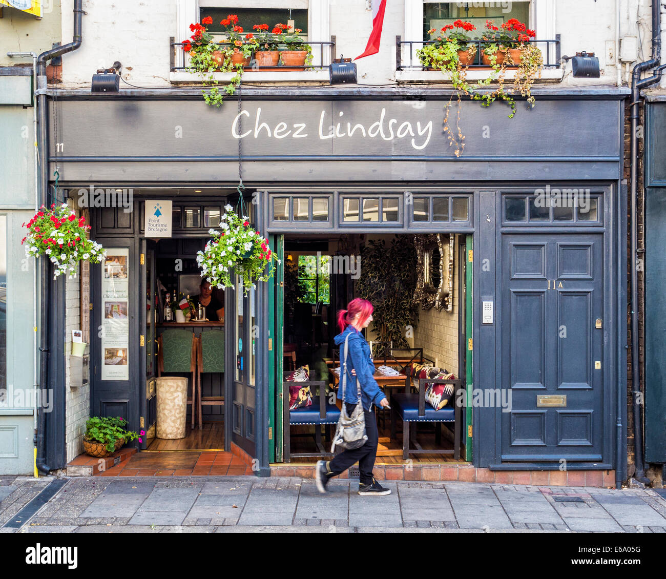 Chez Lindsey restaurant exterior and pedestrian woman with red hair, Richmond upon Thames, Surrey, London, UK - Stock Image