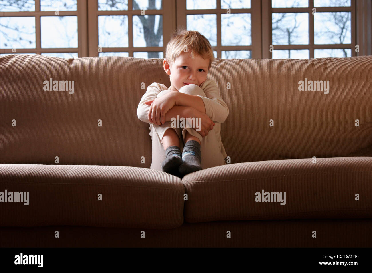 boy,domestic life,sofa - Stock Image