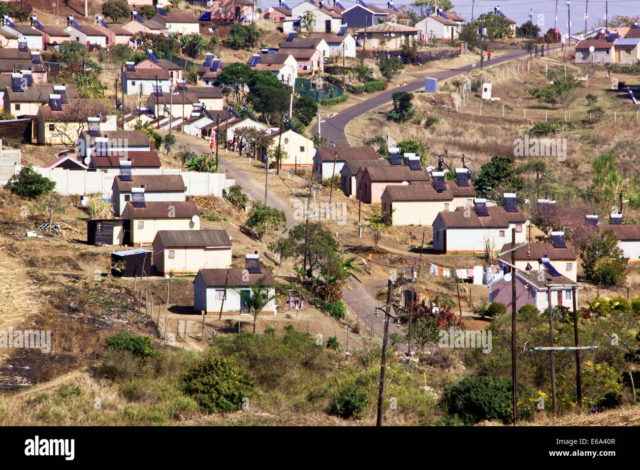 DURBAN, SOUTH AFRICA - JULY 23, 2014: Low cost township houses fitted with solar panels in Verulum in Durban, South - Stock Image
