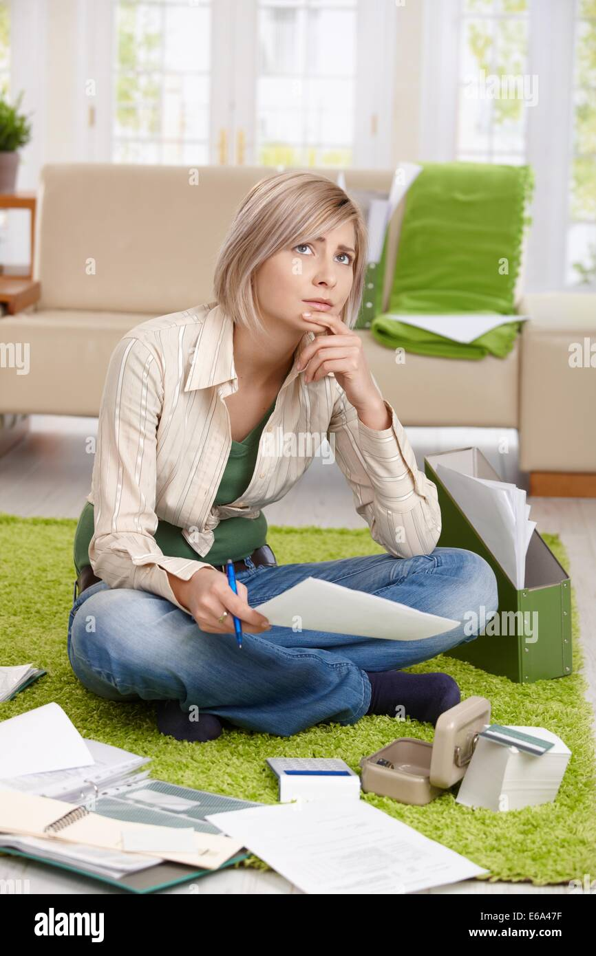 young woman,bankruptcy,housekeeping,financial worry - Stock Image