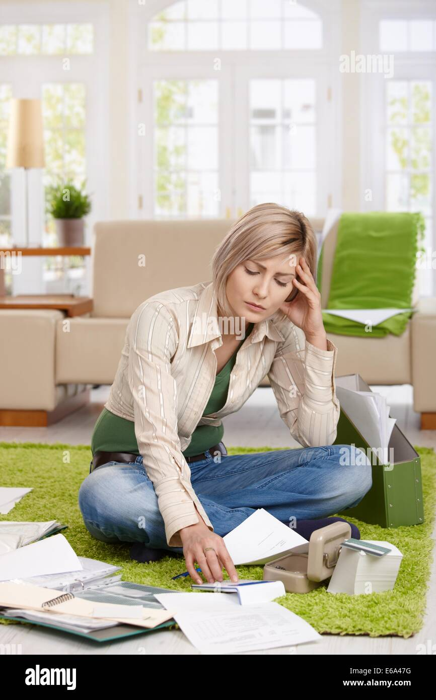 young woman,calculating,housekeeping - Stock Image