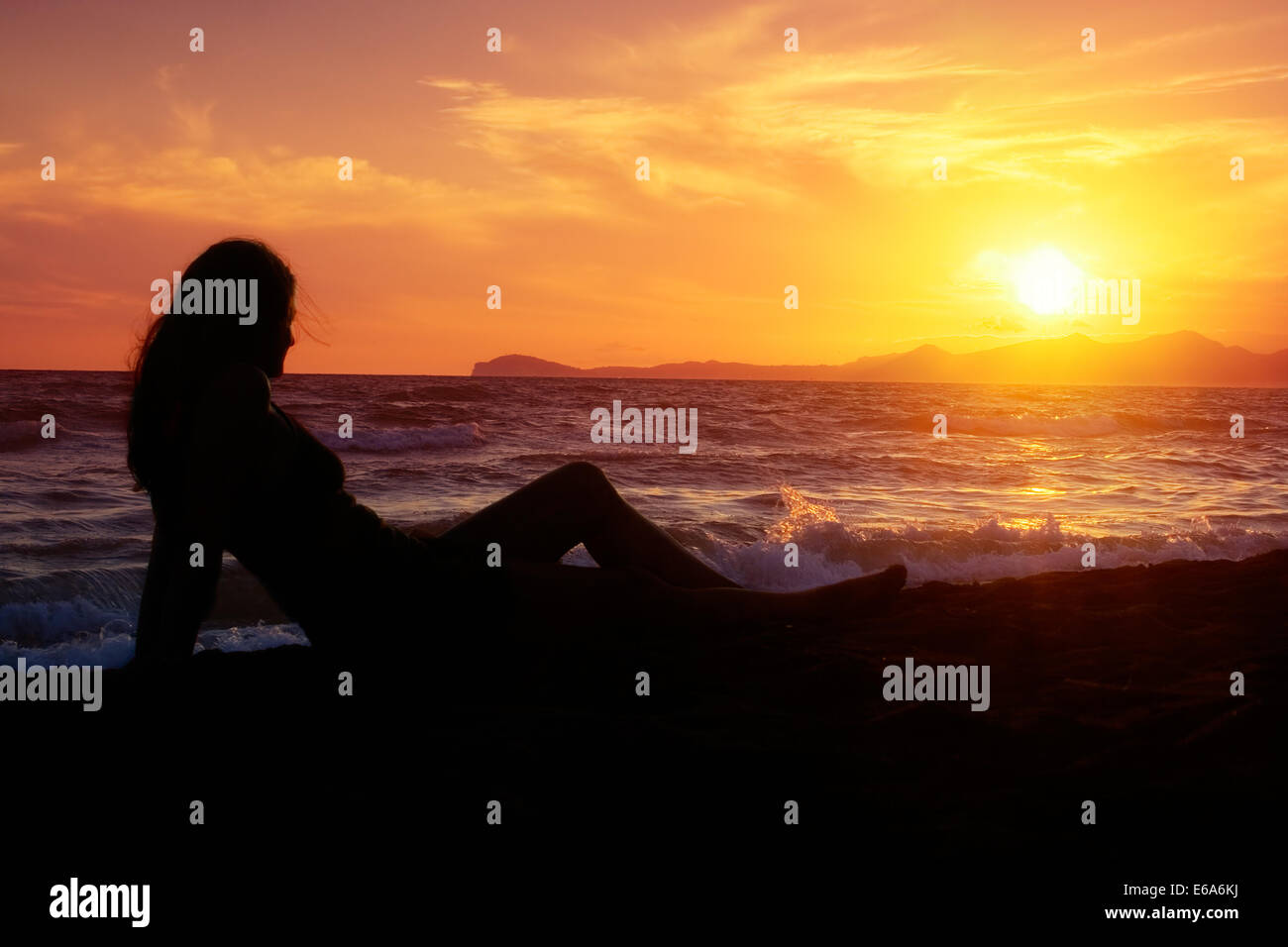 woman,relaxation,recreation,sunset - Stock Image