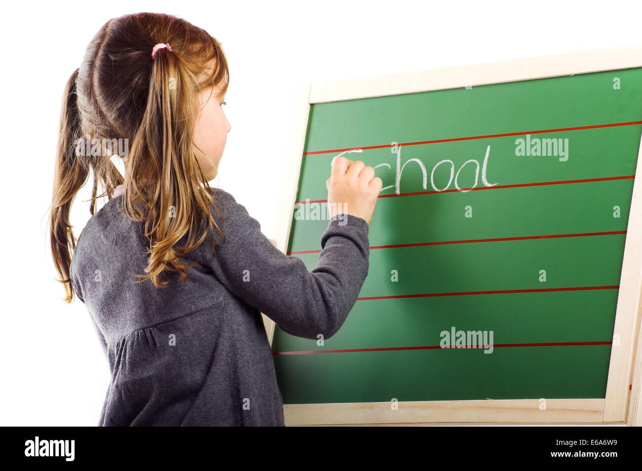 writing,schoolchild,school board Stock Photo