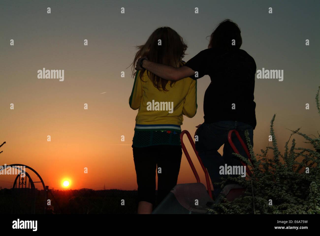 teenager,sunset,romantic,love couple - Stock Image