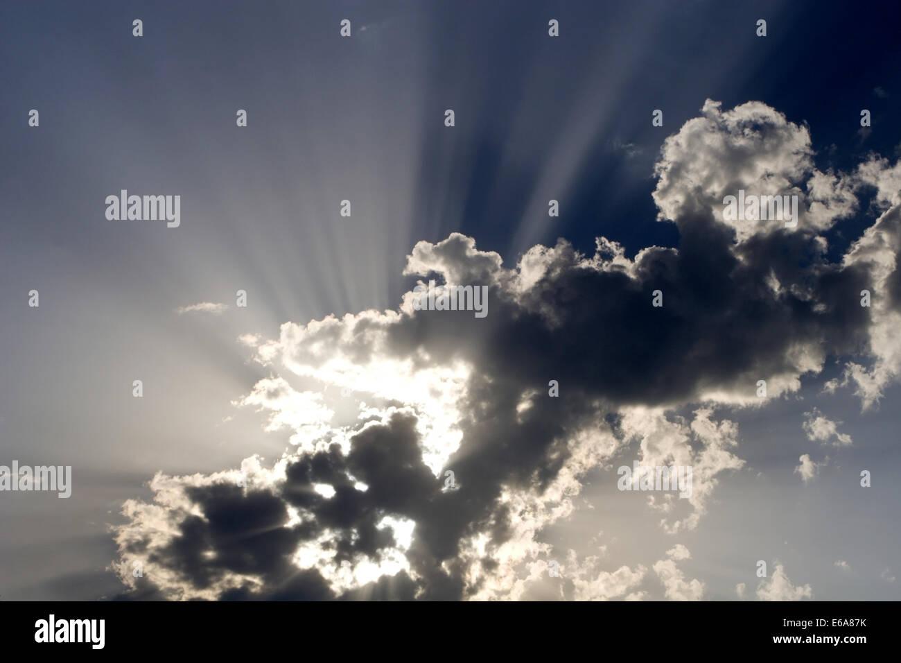 cloudscape,sky only,sunbeam - Stock Image