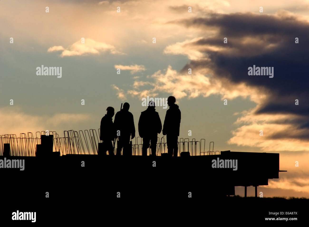 silhouette,construction worker,working - Stock Image