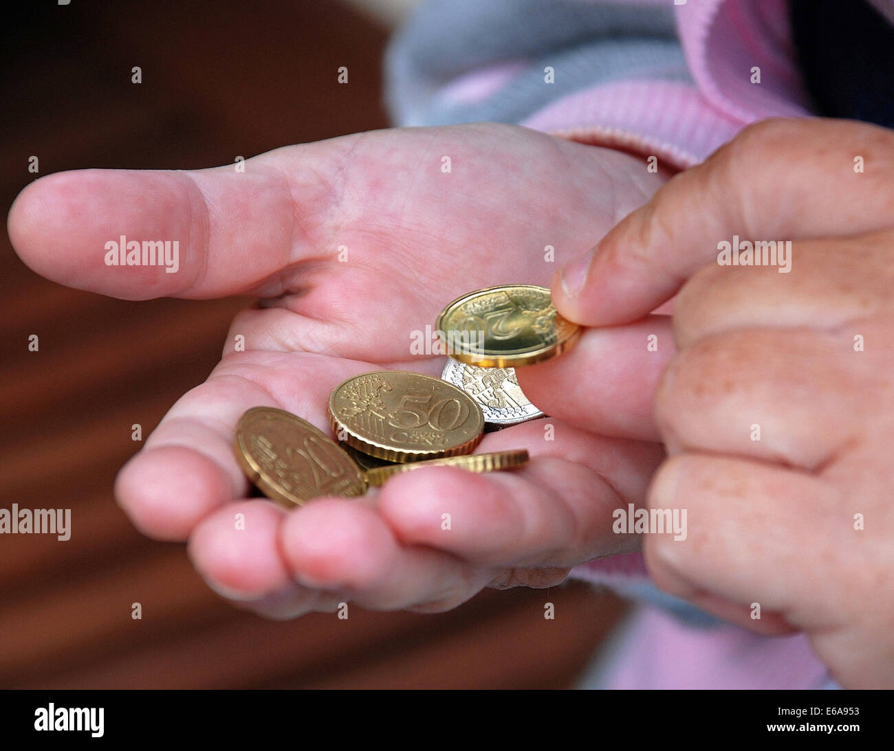 hand,paying,coins - Stock Image