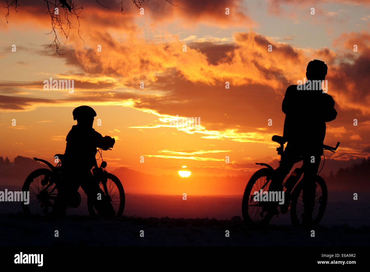 persons,bicycle,silhouette - Stock Image