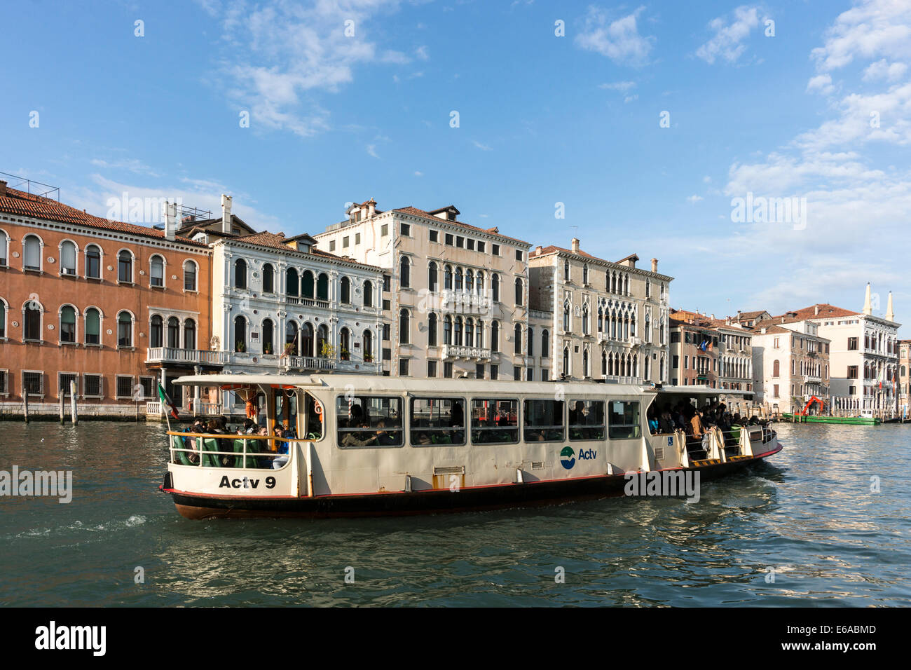 A vaparetto water bus on the Grand Canal in Venice. - Stock Image