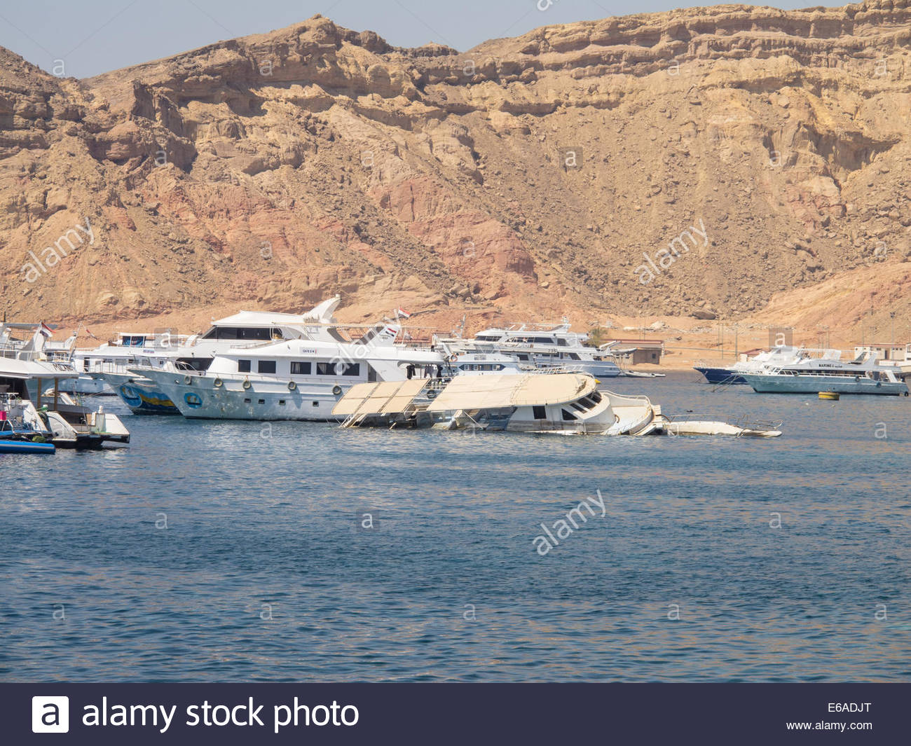 Yacht wreck in the harbour at Ras Mohammed, Egypt - Stock Image