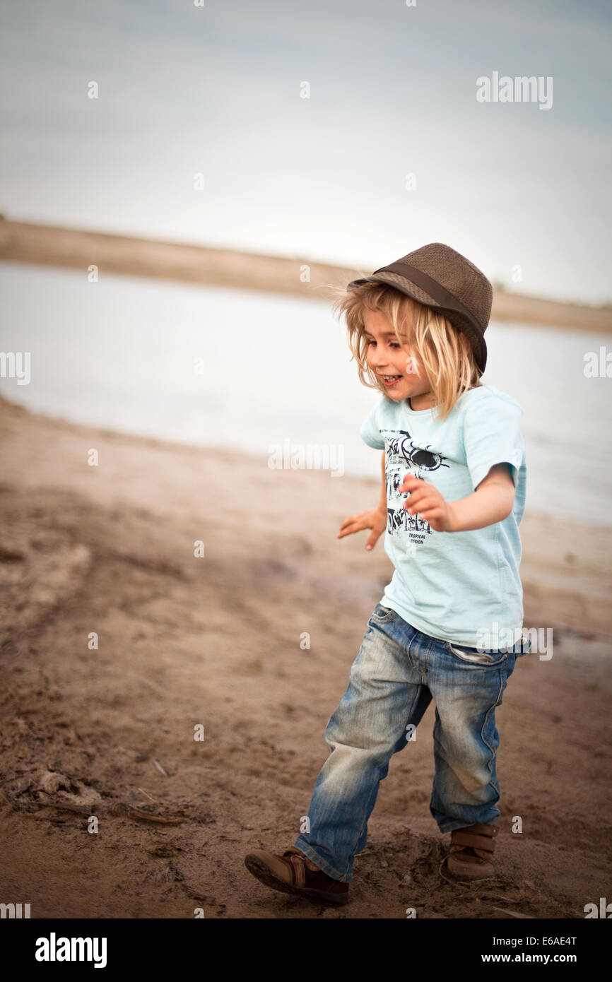 boy,child,happy,fun,happiness,run,dirty,dirt,mud Stock Photo
