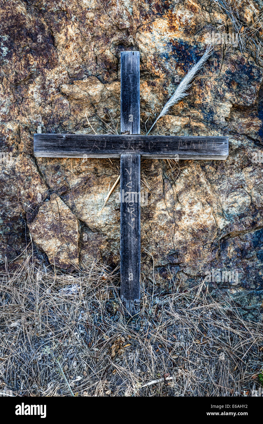 Wooden Cross backed up by Rock on the side of the Road in Big Sur CA - Stock Image
