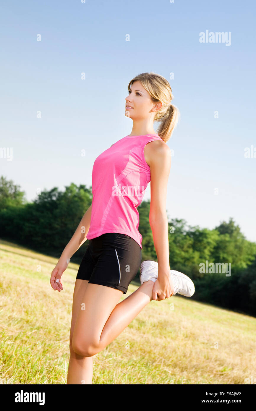 sportswoman,stretching,runner - Stock Image