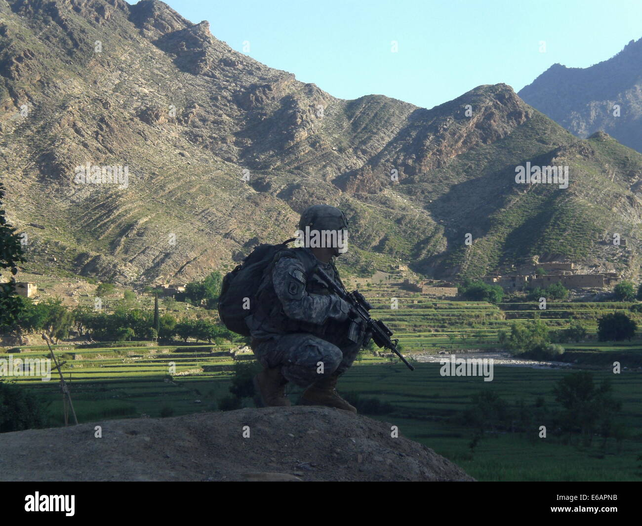 U.S. Army Cpl. Gunnar W. Zwilling provides security while on patrol outside Forward Operating Base Blessing in Kunar - Stock Image