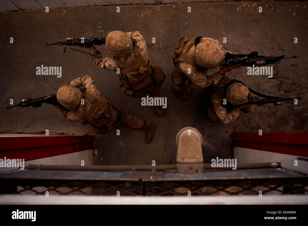 U.S. Marines with India Company, 3rd Battalion, 3rd Marine Regiment practice clearing rooms during training at the Stock Photo
