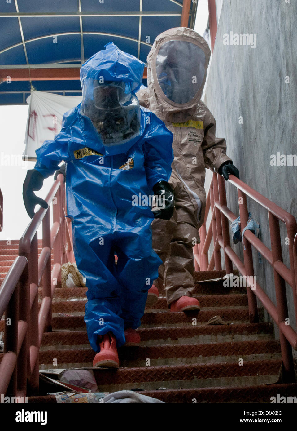 U.S. Army Sgt. Gretchen Martinez, left, and Pvt. Joshua Spearman, both with the 92nd Chemical Company, enter a subway Stock Photo