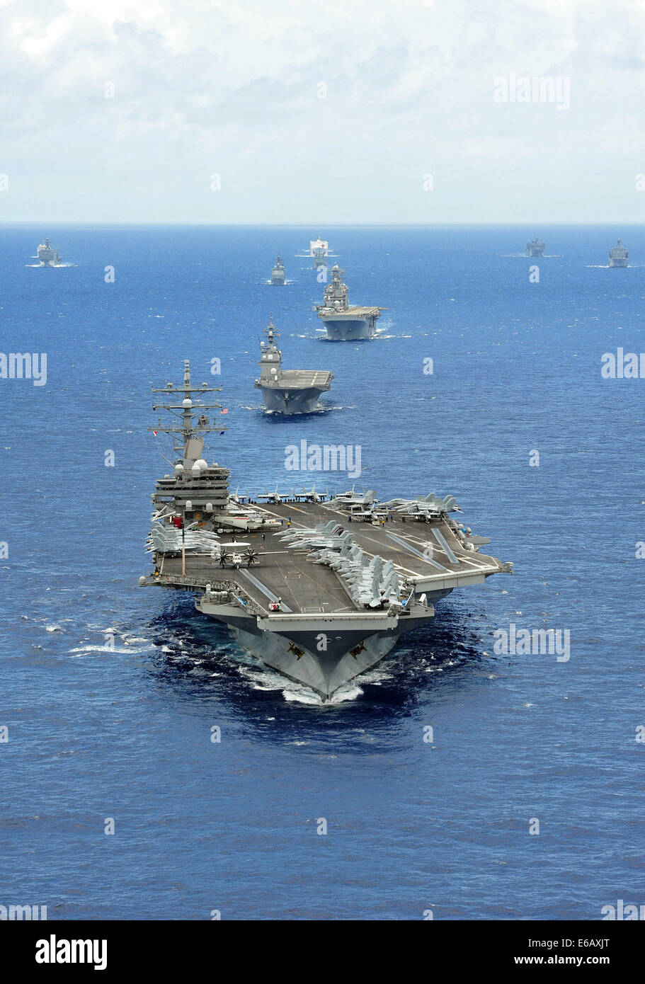 The aircraft carrier USS Ronald Reagan (CVN 76) leads a formation of vessels from 15 international partnership nations - Stock Image