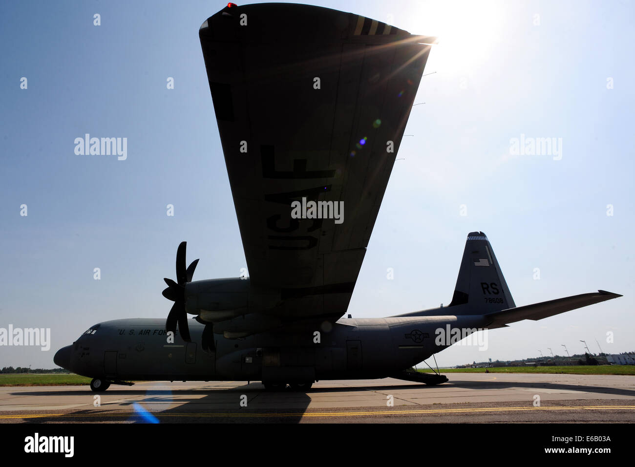 A U.S. Air Force C-130J Super Hercules aircraft prepares for loading and takeoff at Siauliai Air Base, Lithuania, Stock Photo