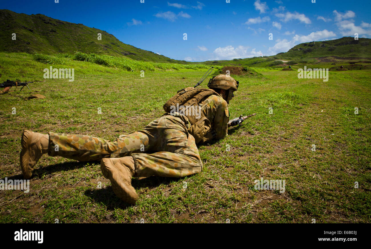 A Marine with Delta Company, 5th Battalion, Royal Australian Regiment, participates in a tactical live fire demonstration Stock Photo