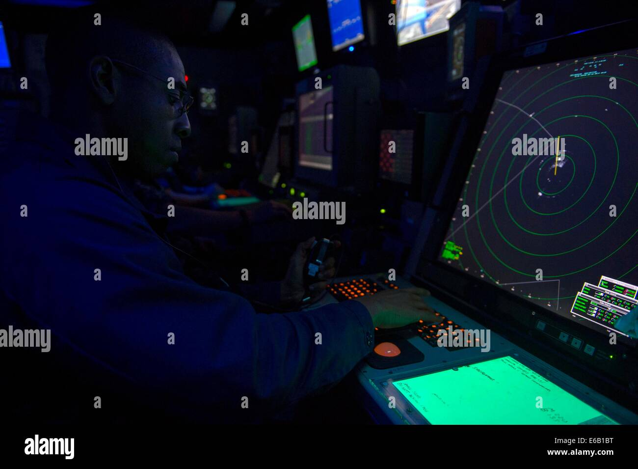 U.S. Navy Air Traffic Controller 1st Class Fernando Montes stands approach control watch in the amphibious air traffic Stock Photo