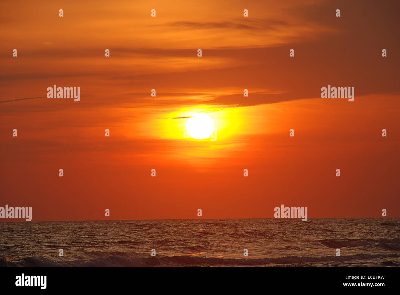 sunrise,sunset,sea - Stock Image