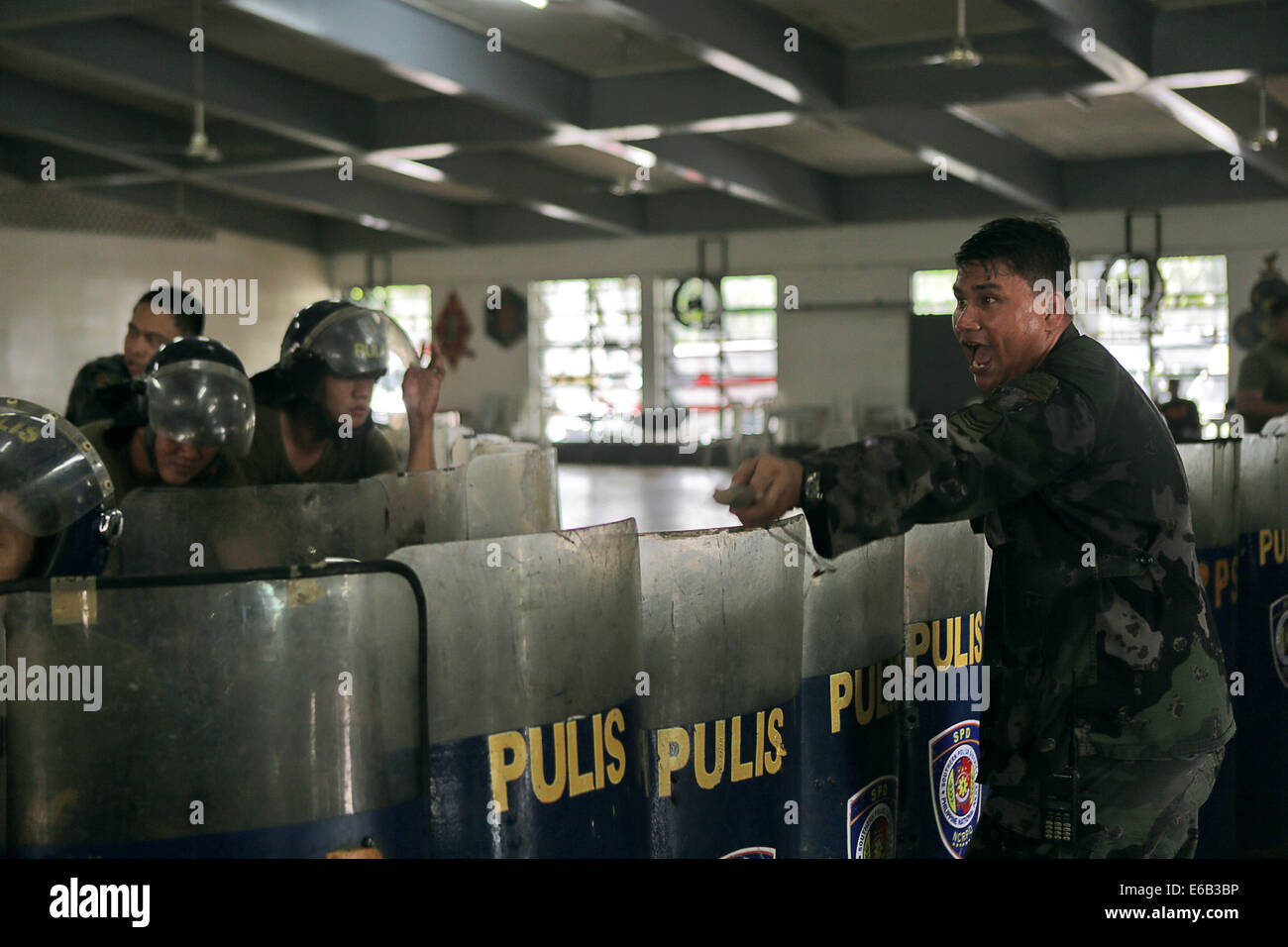 Philippine service members conduct riot control training during Non-Lethal Weapons Executive Seminar (NOLES) 14 - Stock Image