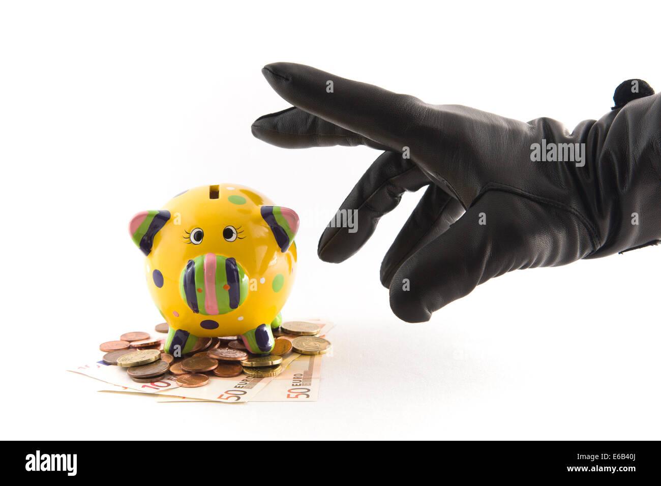 piggy bank,theft,home finances - Stock Image