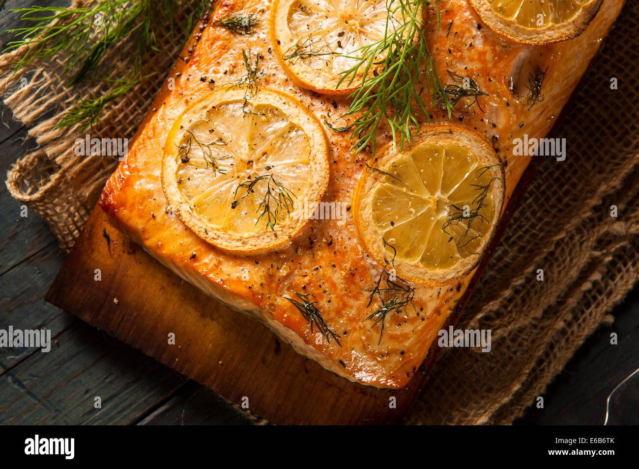 Homemade Grilled Salmon on a Cedar Plank with Dill - Stock Image
